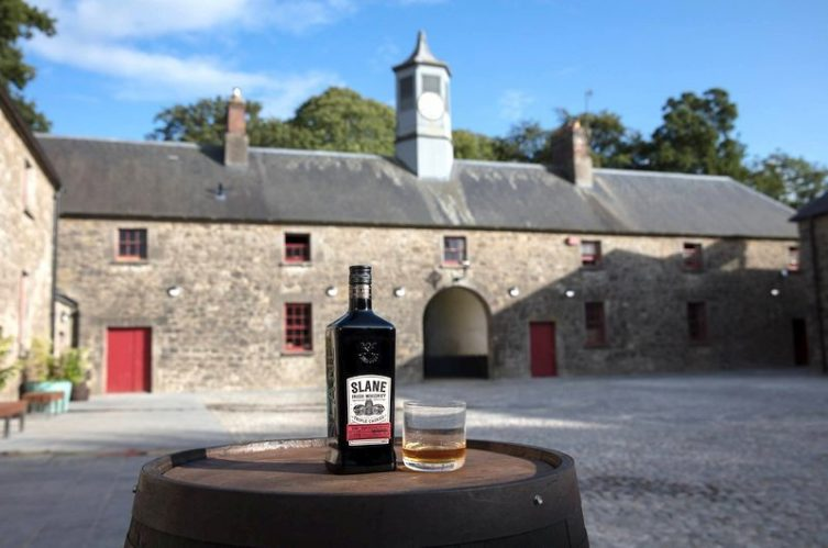 Irish Whiskey Magazine - Slane Distillery - Glass and bottle