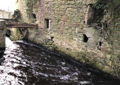 McAllisters Distillery water wheel and stream